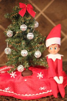 Our Elf on the Shelf got this little Christmas tree at Hobby Lobby for $1.50.  The disco ball decorations were also just $1.50!  That store has lots of elf-sized Christmas things.