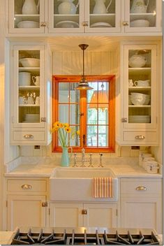 We love this small cottage #kitchen and the open panel doors. www.budgetbathandkitchen.com