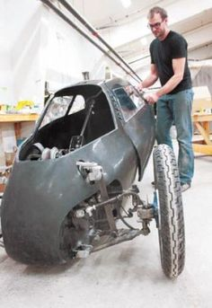 The as-yet-nameless 'hybrid car, motorcycle, kayak bike' designed by Lyon Smith, above, and his partner, Rich Kronfeld, goes on pedal power, electricity (Winona Post).