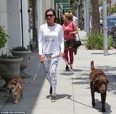 Relaxed:Earlier this week she looked much more comfortable as she wore an off the shoulder white sweater and a pair of printed white and blue leggings while walking her dogs around Beverly Hills on Tuesday