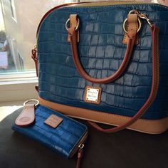 Dooney and Bourke croco satchel Dooney and Bourke croco embossed satchel. Used 2 times! In amazing condition! Comes with dust bag, wallet(iPhone size) and key fob! Color is a pretty teal! More info in comments. HOST PICK 2X!!  Dooney & Bourke Bags Satchels