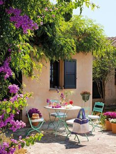 Lush greenery and vibrant flowers set the stage for meals al fresco