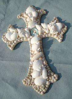 Cross Wall Art Seashell Beach Cottage Decor Beach Wedding Gift. $29.99, via Etsy.
