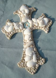 Cross Wall Art Seashell Beach Cottage Decor Beach Wedding Gift. $29.99, via Etsy.