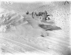 A Bren gun carrier throwing up a cloud of sand while crossing the desert at…