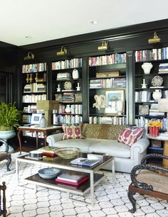 Love the dramatic bookshelves balanced by the patterned carpet. Bunny Williams library via La Dolce Vita.