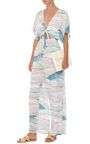Beachwear mavens **Mara Hoffman** is known for their delicious swimwear and ready-to-wear that seamlessly complements. This alluring jumpsuit has a lightweight finish printed with a deep sea motif in a pale hue. Wear with a beach bag during the day or a clutch for evening—certainly a versatile piece.