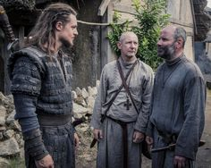 "Alexander Dreymon as Uhtred of Bebbanburg (with Ian Hart as Father Beocca and Cavan Clerkin as  Pyrlig) in ""The Last Kingdom"" Season 2 From http://www.farfarawaysite.com/section/lastkingdom/gallery2/gallery5/gallery.htm"