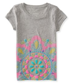 """Finish your newest crafty creation in the artsy style of our Mandala Puff Graphic T! A rubberized puff mandala in bright neon hues on the front features dots, triangles, circles and daisy shapes for playful appeal.<br><br>Tag free label.<br>Relaxed fit. Approx. length (10): 22""""<br>Style: 5637. Imported.<br><br>100% cotton.<br>Machine wash/dry."""