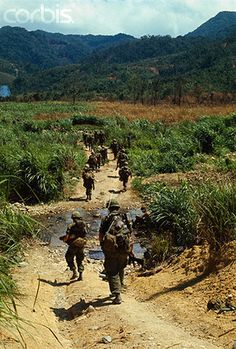 02 May 1968, A Shau Valley, South Vietnam --- A Communist built road serves as a footpath for members of the 1st Cavalry Division during Operation Delaware in the A Shau Valley. The road was built with metal strips, normally used by allied forces for constructing landing strips. It was disclosed April 28th that the cavalrymen had invaded the valley and fought a costly battle to establish a foothold in the Communist enclave
