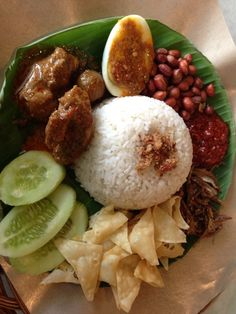 Nasi Uduk - Traditional Indonesian Rice with Spicy Peanut, Boiled Egg, Cucumber, Chicken and Scrambled Egg