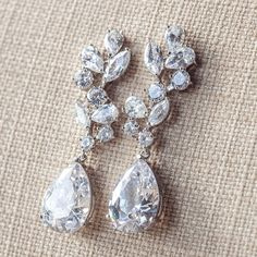 Gorgeous long sparkly floral earrings in a silver setting with clear crystals - stunning and classic!  ~ ❤ 2.16 long ~ ❤ Silver metal setting with