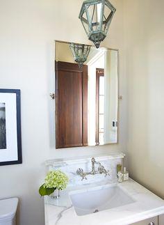 Suzie: Urban Grace Interiors - Chic powder room design with turquoise blue painted lantern ...
