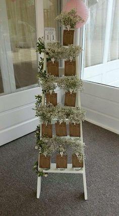 Step ladder seating plan with gypsophila / http://www.himisspuff.com/rustic-babys-breath-wedding-ideas/13/