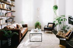Sofa: West Elm | Bookshelves: Self-built | Coffee table: West Elm | Black chair: Brimfield Antique Show | Brown chair: Barcelona chair | Rug: Overstock
