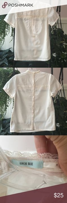 Kimchi Blue top Kimchi Blue cream short sleeve top. Beautiful race on top. Button up all the way in the back. Urban Outfitters Tops Blouses