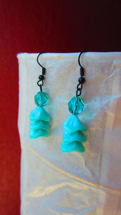 Fun origional handmade teal multi beaded earrings. $15.00, via Etsy.