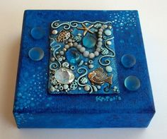 Under the Sea Gallery wrapped canvas from MandarinMoon's Etsy shop.  Acrylic painting on gallery wrap canvas features a polymer clay focal piece with faux pearls, glass gems and metal fish, sea turtle and starfish.  Love the technique!