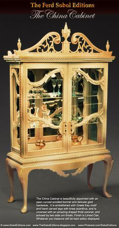 The Ferd Sobol Editions China Cabinet is beautifully appointed with an open curved scrolled bonnet and delicate gold hardware.  It is embellished with Greek key motif and hand carved legs with delicate knee acanthus, and crowned with an amazing draped finial coronet, and echoed by two side urn finials. Finish is Limed Oak. Whatever you treasure will be kept safely displayed. 1/12th scale www.SobolEditions.com      www.TheSobolEditions.blogspot.com