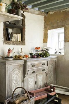 A beautiful cabinet finished with Old White Chalk Paint® decorative paint by Annie Sloan in Annie's kitchen in Normandy, France. Photography by Christopher Drake.