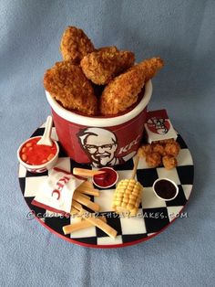 This is my KFC chicken bucket and sides cake. I did the silly thing and asked my two boys what should daddy's cake b Fondant Flower Cake, Fondant Cakes, Fondant Bow, Fondant Tutorial, Fondant Figures, Crazy Cakes, Mc Donald Cake, Kfc Cake, Realistic Cakes