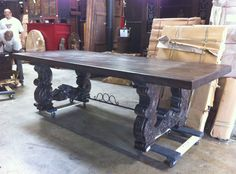 A customer emailed us a photo of a table that he saw in a model home and we copied it at our factory in India.  When it came in we shipped it to his home in Miami and ordered this item for our stock inventory in numerous sizes.  www.SanDiegoRustic.com