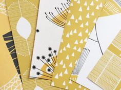 A collection of cheerful yellow MissPrint wallpaper samples.