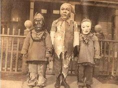Creepy old Halloween photo where the children made their own masks! These are scarier than the more developed ones they make today!