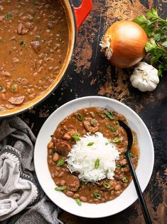 Louisiana Style Red Beans and Rice Recipe - Budget Bytes - A serving of red beans and rice next to the pot full of red beans. You are in the right place about - Louisiana Recipes, Cajun Recipes, Bean Recipes, Southern Recipes, Rice Recipes, Pork Recipes, Dinner Recipes, Cooking Recipes, Dinner Ideas
