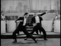 The Nicholas Brothers. Astounding performance. This is a clip of the whole dance from the 1943 film Stormy Weather.