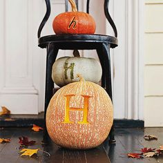 Monogrammed Pumpkins - Carve a monogram into pumpkins and place them on your front porch to welcome guests to your bewitching abode. Using a small, medium, and large pumpkin, carve the initial in different sizes and fonts. Layer the pumpkins on an old chair or stool to show off your handiwork.