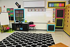 This is the exact theme I want for 2014-2015 Black and bright colors. Love everything about this classroom.