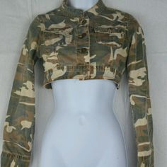 Brown And Green Camoflage Cropped Jacket This is a very cute jacket from Rue 21. It is brown and green camoflage, and has 4 large buttons in the front as well as 2 pockets. It has long sleeves and is cropped just below the breast line. This is a size small. Rue 21 Tops Crop Tops