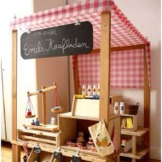 Play grocery store.... I would have loveddd this! I loved going to OMSI and playing with the conveyor belt thing :)