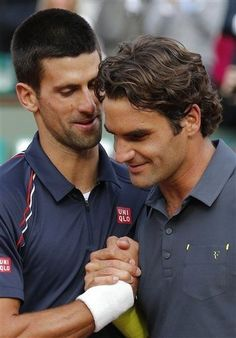 Serbia's Novak Djokovic, left, and Switzerland's Roger Federer meet at the net after their semifinal match in the French Open tennis tournament at the Roland Garros stadium in Paris, Friday, June 8, 2012. Djokovic won 6-4, 7-5, 6-3. (AP Photo/Michel Euler)