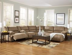 Furniture. Light Brown Faux Leather Couch With Reclining Combined With Small Rectangle Dark Brown Wooden Coffee Table In Light Gray Painted Living Room Wall. Awesome Small Brown Leather Couch For Your Lovely Living Room