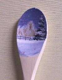 Landscape scene painted onto a wooden spoon