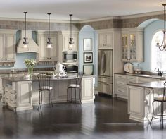 Cream cabinets with coconut grey stone glaze in traditional by Diamond Cabientry