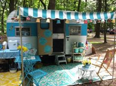 I need this awning! Will match my camper!-ab.  Vintage Camper LOVE those rugs!