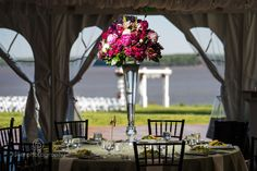These jewel toned centerpieces were a show stopper at Claire and Steven's bohemian inspired wedding. Fuller Photography