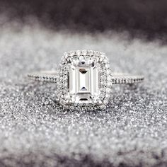 Wow! This ring is so pretty! I love the delicate band and the double halo around the emerald cut diamond center <3 So gorgeous!