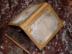 Nacre and gold carnet-de-bal; Charles X; French.