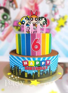 The Powerpuff Girls birthday party rainbow cake! See more party planning ideas at CatchMyParty.com!