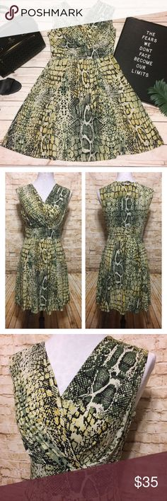"""⚡️Flash Sale Jonathan Martin Snake Print Dress Gorgeous dress by Jonathan Martin in a green and tan snake print over a light gray background. Crossover faux-wrap style fitted bodice. Defined waist. Skirt that drapes just perfectly over the hips and comes to the knees. Modest neckline. Flawless condition. ⚡️Flash Sale Price Firm  Measurements lying flat: • Bust 17.5"""" from armpit to armpit  • Length 34"""" from shoulder to bottom hem Jonathan Martin Dresses Midi"""