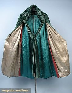Emerald green w/ ruched collar & back detail, ties at neck, lined w/ gold lame, pink velvet & green silk charmeuse,