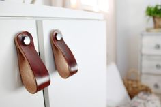 A pretty way to update any furniture using DIY leather pulls for a modern rustic look.