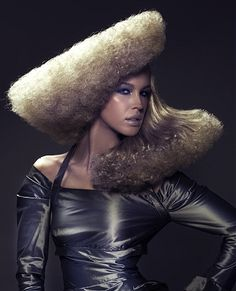A long blonde curly coloured frizzy sculptured avant garde hairstyle by Royston Blythe