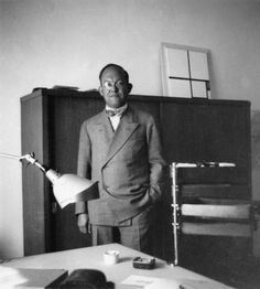 Jan Tschichold (with Midgard lamp in foreground) Photographer/date unknown (please advise if you know).