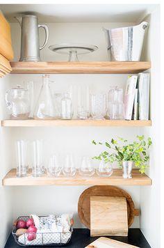 Open shelves add a modern touch.   domino.com