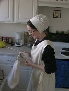 Quaker Jane in baking cap and apron